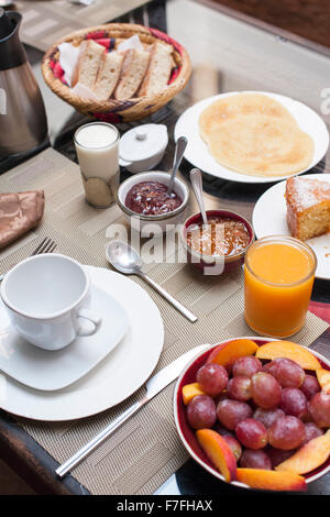Breakfast as served at Riad El Zohar in Marrakech, Morocco. - Stock Photo