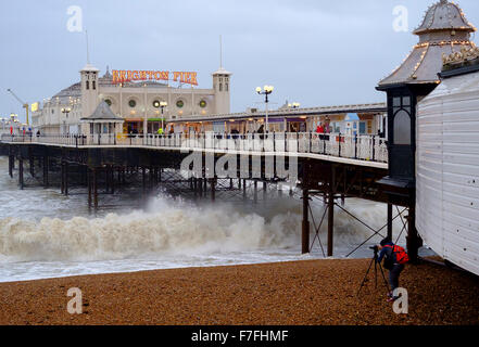 Brighton, UK. 30th Nov, 2015. With winds gusting to  60 mph and the pier in Brighton facing stormy seas, a photographer - Stock Photo