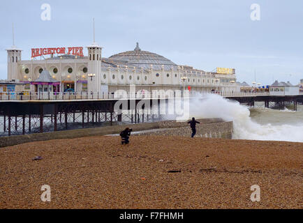 Brighton, UK. 30th Nov, 2015. With winds gusting to  60 mph and the pier in Brighton facing stormy seas,  one young - Stock Photo