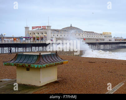 Brighton, UK. 30th Nov, 2015. With winds gusting to  60 mph, and an almost deserted beach, the pier in Brighton - Stock Photo