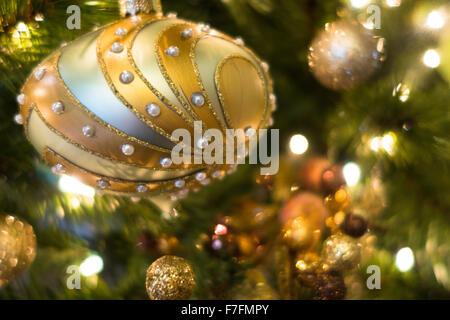 Beautiful Christmas ornaments are hung on an elegant Christmas ...