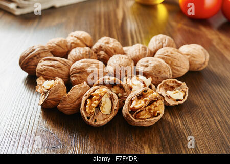 Walnuts on wooden table close up - Stock Photo