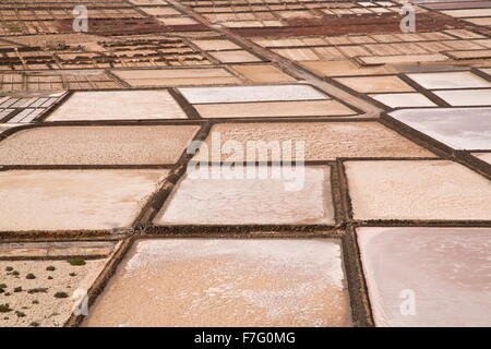 Active saltpans, or Salt evaporation ponds, at Salinas de Janubio, Lanzarote. - Stock Photo