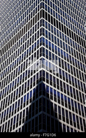 Detailed and abstract view of a modern building in Midtown Manhattan, New York City. Building shadow on high-rise - Stock Photo