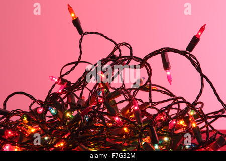 A tangle of indoor Christmas fairy lights in a domestic setting - England - Stock Photo