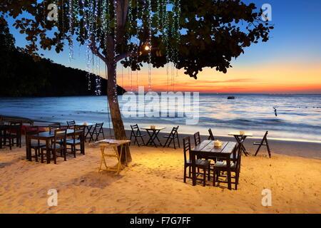 Beach restaurant at sunset, Lima Coco Resort, Ko Samet Island, Thailand - Stock Photo