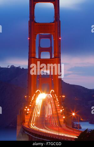 Golden Gate Bridge with commute traffic at night  Commute traffic at night in San Francisco, California - Stock Photo