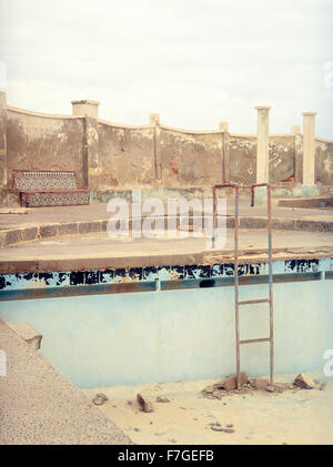An abandoned and decaying swimming pool in Sidi Ifni ia former Spanish colony on the West coast of Morocco, North - Stock Photo