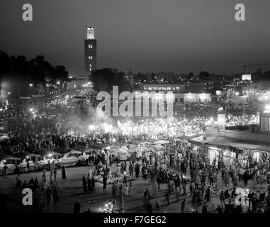A view of food stalls in the marketplace and public square Place Jema al Fna in Marrakech during dusk. Marrakech, - Stock Photo