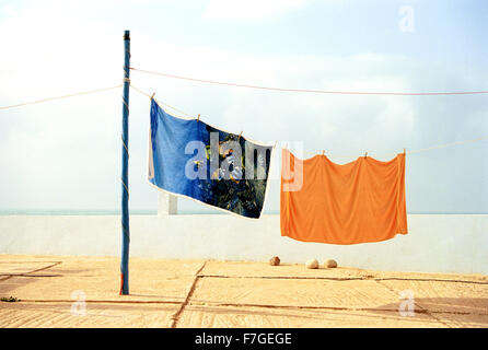 Colorful beach towels hand to dry at a camping ground in Sidi Ifni. Morocco - Stock Photo