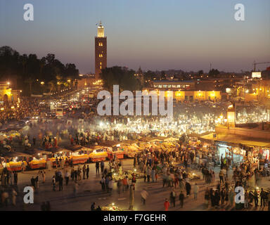 A view of food stalls in the marketplace and public square Place Jema al Fna in Marrakech at dusk. Marrakech, Morocco - Stock Photo