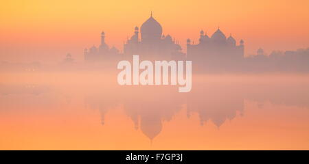 Landscape view of Taj Mahal skyline with reflexion on the water, Agra, Uttar Pradesh, India - Stock Photo