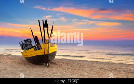 Fishing boat at Baltic Sea, sunset time, Pomerania, Poland - Stock Photo