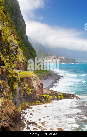Cliff coastline near Ponta Delgada, Madeira Island, Portugal - Stock Photo