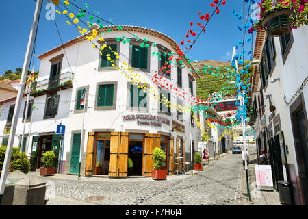 Street decorated with paper flowers on feast of Madeira, Camara de Lobos, Madeira, Portugal - Stock Photo