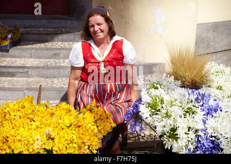 Flowers seller in Funchal market, Madeira, Portugal - Stock Photo