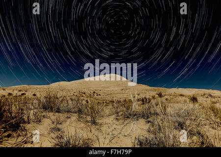 Kelso Dunes, Mojave National Preserve with star trails - Stock Photo