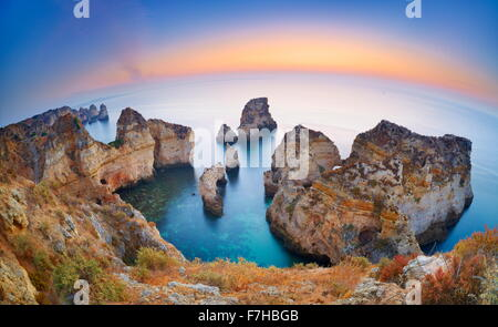 Algarve coast before sunrise, Ponta da Piedade, Algarve, Lagos, Portugal - Stock Photo