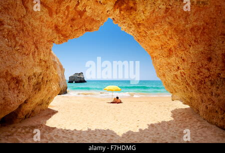 Tourist relaxing at Prainha Beach near Alvor, Algarve, Portugal - Stock Photo