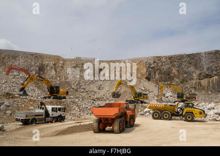 Demonstration of excavators and dump trucks at Hillhead Quarrying Recycling and Construction Exhibition - Stock Photo