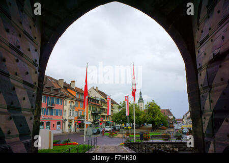 Town Bulle thorugh Gate of Castle, Canton Fribourg, Switzerland - Stock Photo
