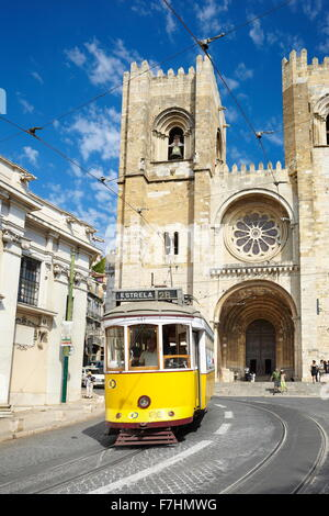 Tram 28, most famous line tram and Sé Cathedral, Alfama district, Lisbon, Portugal - Stock Photo