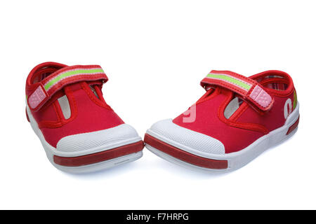pair of red child  sneakers isolated on white background - Stock Photo