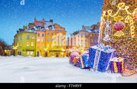 Outdoor winter snow christmas tree decoration , Warsaw, Poland - Stock Photo