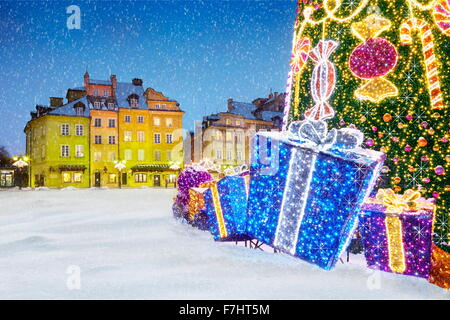 Outdoor snow christmas tree decoration with gifts, Warsaw, Poland - Stock Photo