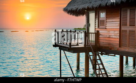 Tropical sunset landscape at Maldives Island, Indian Ocean - Stock Photo
