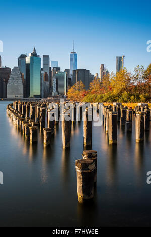 Lower Manhattan skyline at sunset from Brooklyn Bridge Park, Brooklyn, New York, USA - Stock Photo