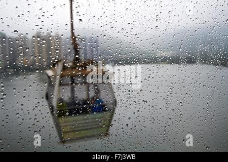 View of Cable Car from a passing Cable car through water drop covered window - Stock Photo