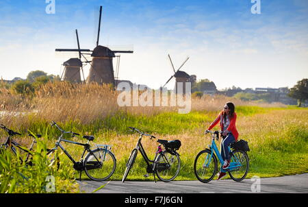 Landscape view with windmills and bicycles - Kinderdijk, Holland Netherlands - Stock Photo