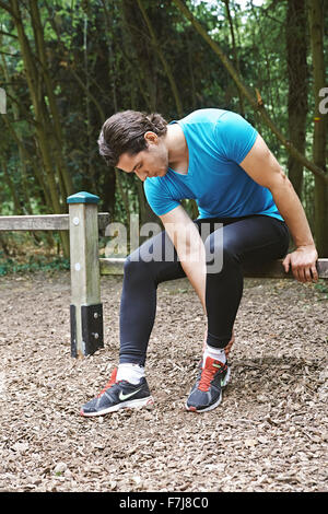 MAN WITH ANKLE PAIN - Stock Photo