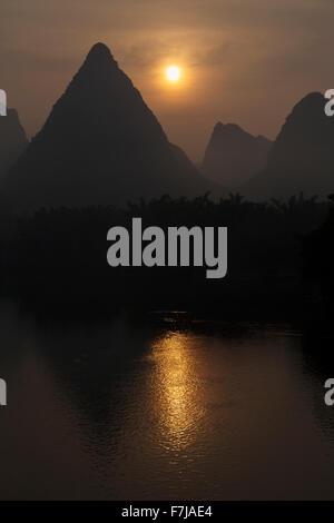 Sunrise over Limestone Karst Formations Guilin Region Guangxi, China LA008233 - Stock Photo