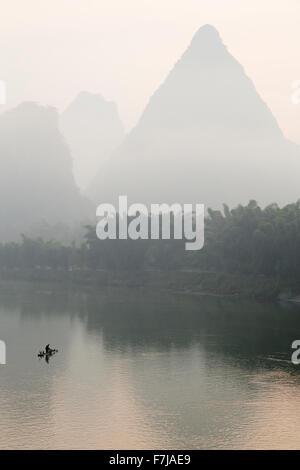 Fiaherman of River Li in Early Morning Guilin Region Guangxi, China LA008235 - Stock Photo