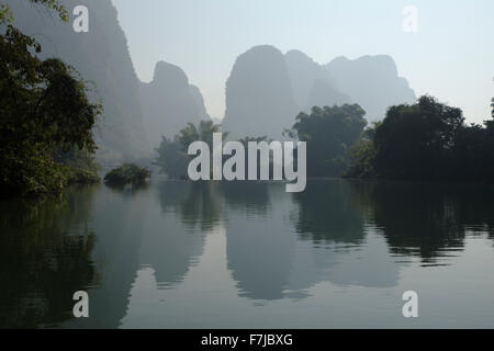 Limestone Karst Formations reflected in River Li Guilin Region Guangxi, China LA008258 - Stock Photo