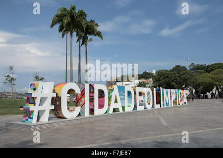 View of Praça Mauá with the #CIDADEOLIMPICA sign prominent in front of palm trees. Olympic Games, Rio de Janeiro, - Stock Photo