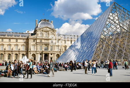 Turists resting at Louvre Museum, Paris, France - Stock Photo