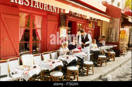 Turists in Restaurant, Montmartre District, Paris, France - Stock Photo