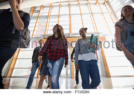 High school students arriving at school - Stock Photo