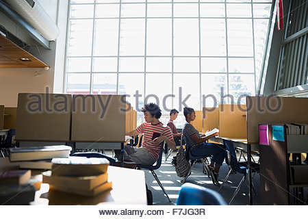High school students studying in library - Stock Photo
