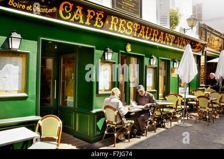 Bar Restaurant in Montmartre District, Paris, France - Stock Photo