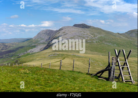A view of the stile at Craig Las (660 m.) looking over the mountain side towards the  summit of Cader Idris (890m) - Stock Photo