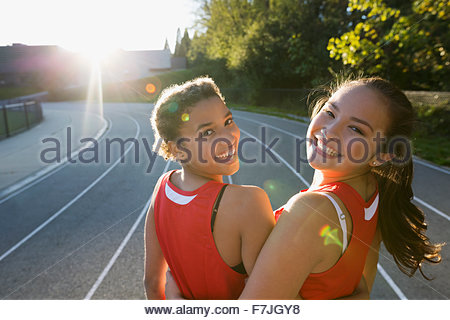 Portrait female high school track and field athletes - Stock Photo