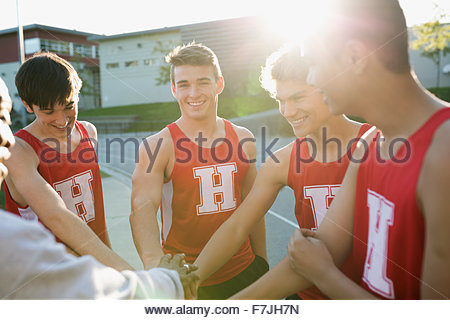 High school track and field team huddle - Stock Photo