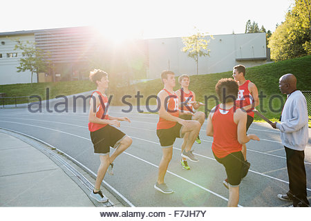 High school track and field team warming up - Stock Photo