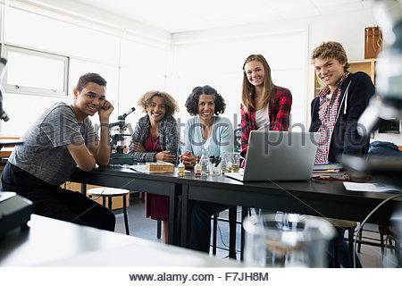 Portrait confident high school students and science teacher - Stock Photo