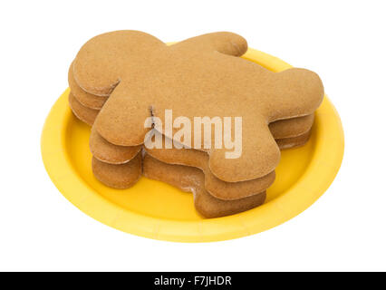 ... Three freshly baked gingerbread men on a small paper yellow plate isolated on a white background  sc 1 st  Alamy & Three Gingerbread Men on a White Background Stock Photo: 91620905 ...