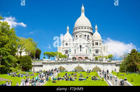 Tourists on the steps in front of the Basilica of The Sacred Heart (Du Sacre-Coeur), Montmartre District, Paris, - Stock Photo